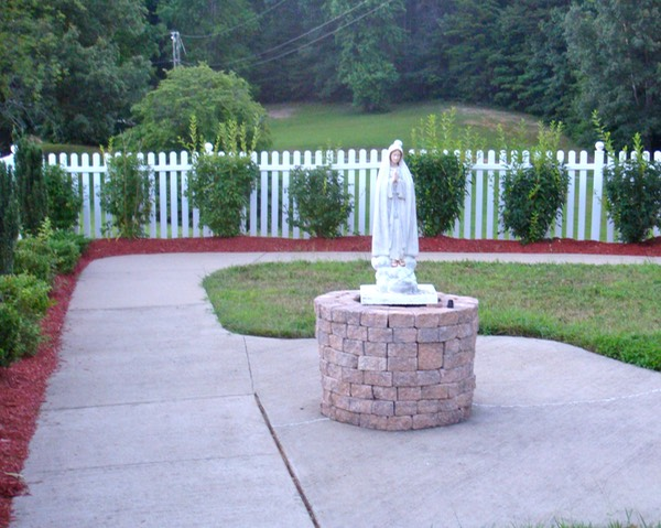 A statue of Mary in the garden